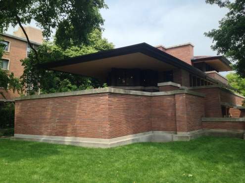 The Robie House sails along the street...