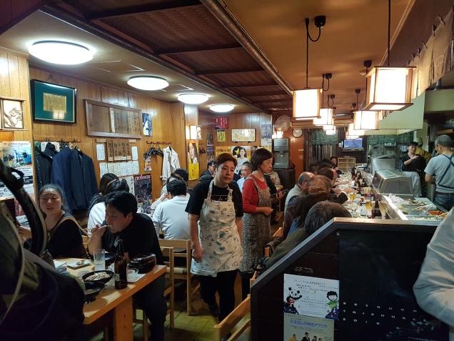 a busy izakaya in Takamatsu