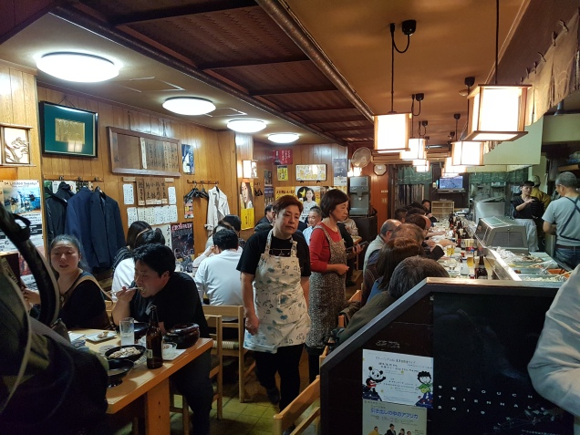 a busy izakaya in Takamatsu