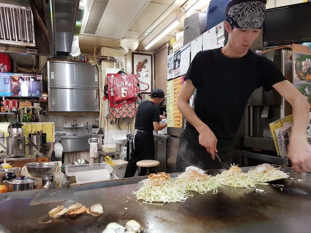 okonomiyaki being prepared in Hiroshima