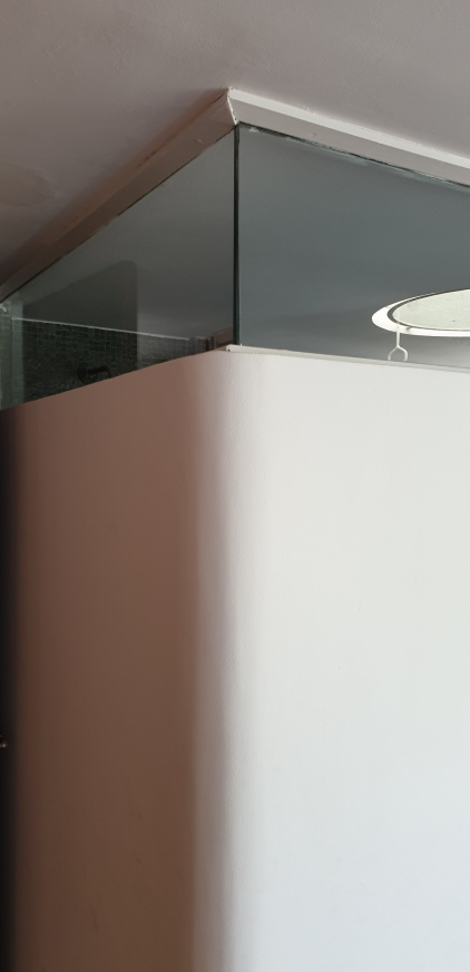 slice of window letting in additional light to top-lit bathroom